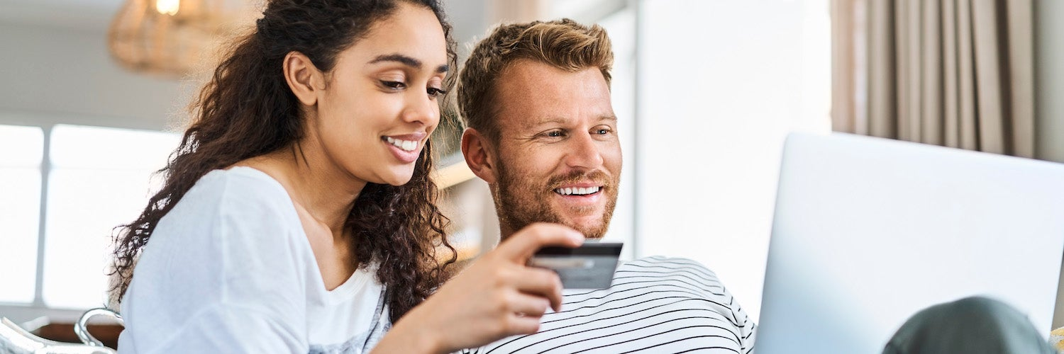 Man and woman looking at credit card