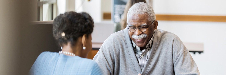 Senior citizen getting financial advice