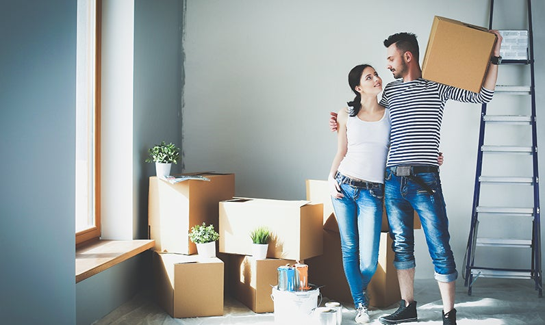 A couple moving into a house together