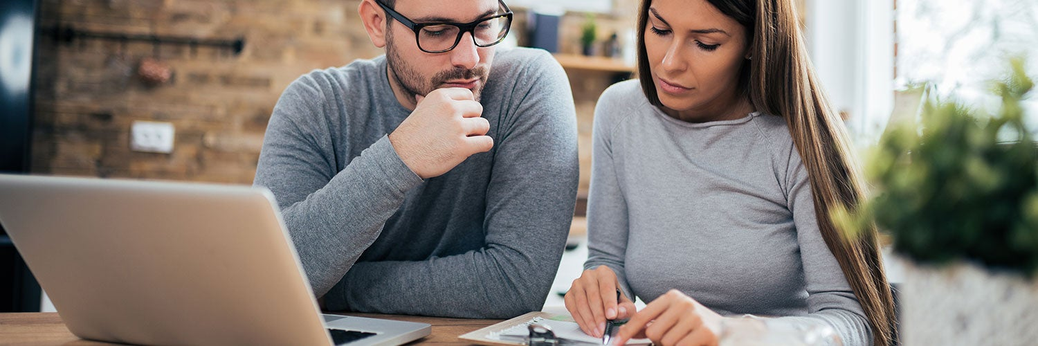 A man and a woman review their finances together.